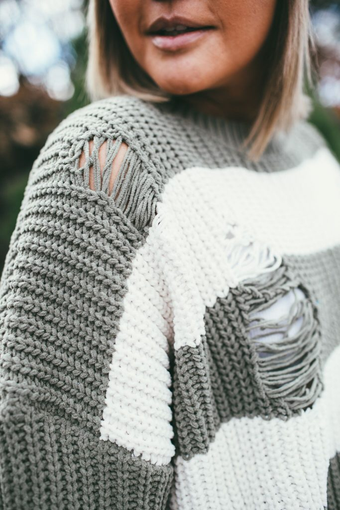 green thick striped sweater