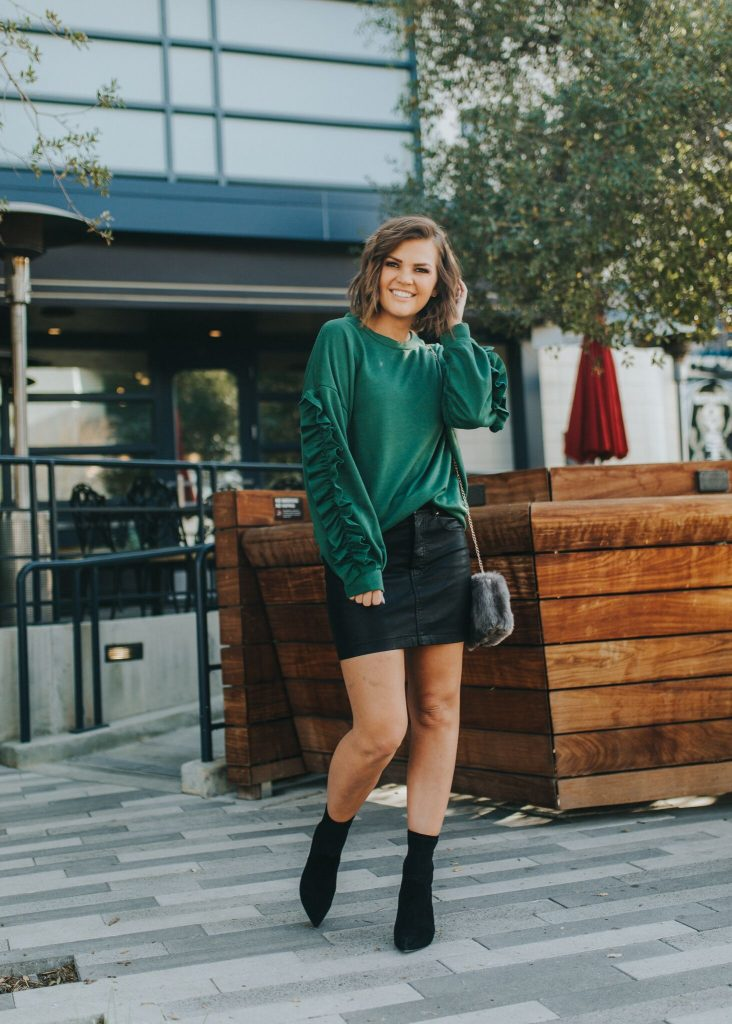 Green Ruffle Sleeve Sweatshirt and black mini skirt
