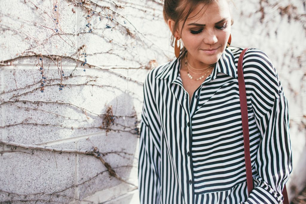 long striped blouse and baublebar gold jewelry