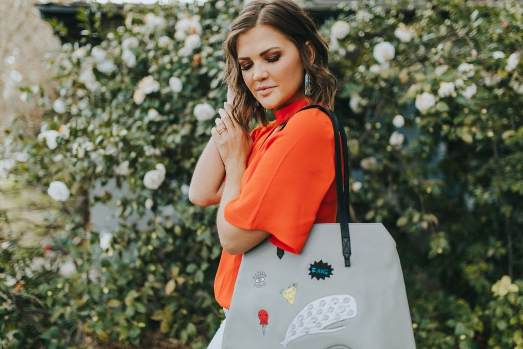 Coral Keyhole Blouse and Min and Mon Miranda Tote and Kendra Scott Abalone Earrings