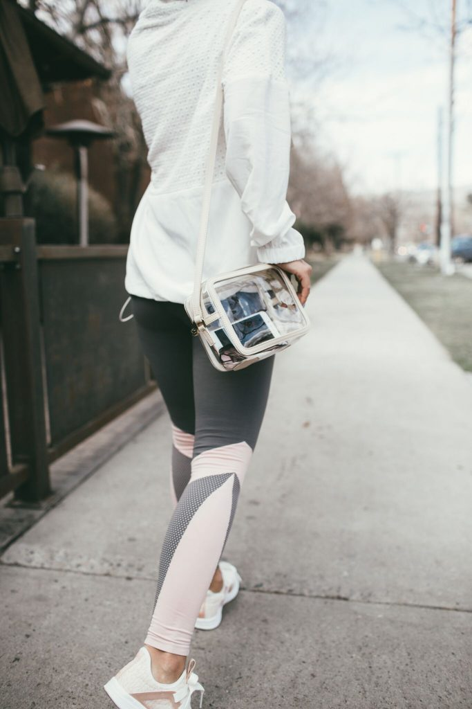 White workout jacket and clear Gigi New York Bag