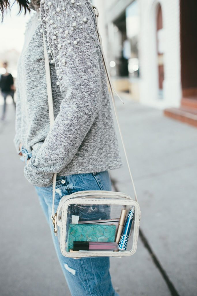 pearl embellished sweater and jeans