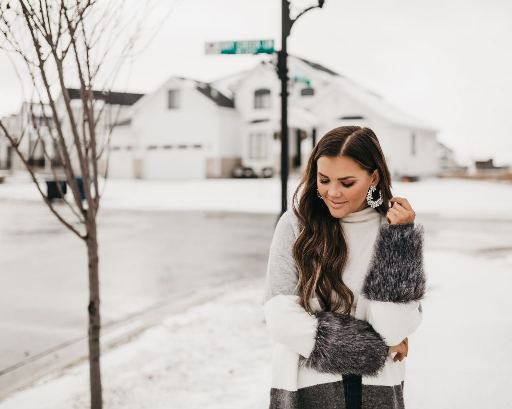 Fur Sleeve Coco and Carmen sweater and baublebar crystal earrings