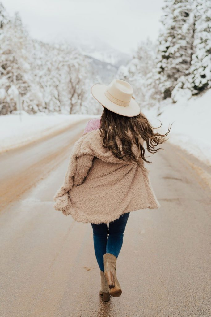 brown fuzzy coat and Free People Stormy Pullover sweater