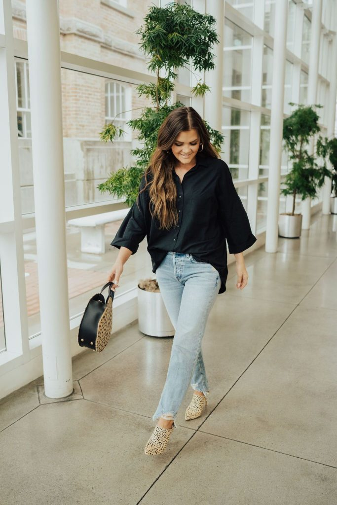 lulus black blouse, free people chewed up distressed jeans and leopard dolce vita heels